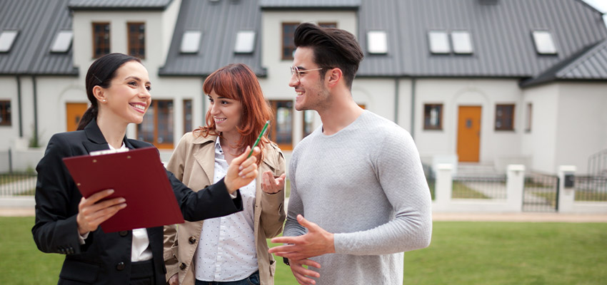 young couple buying real estate reb
