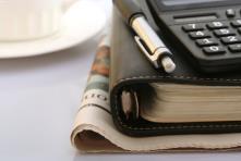 calculator folder newspaper