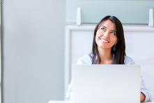 happy businesswoman with laptop