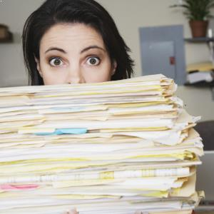 women with pile of files