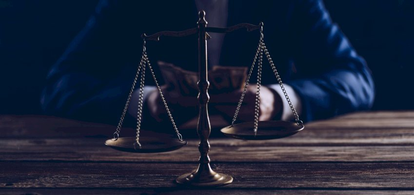 Scales of Justice, man in suit, property listing, assault charge, defamation suit